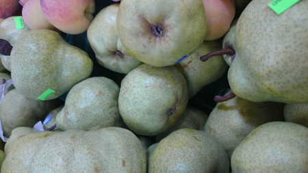 buttery:  Bartlett pear, William pear, Pyrus communis, European cultivar with typical pear shaped yellow fruits often dotted with darker grey, sweet soft buttery juicy flesh, used raw, canned or in pies