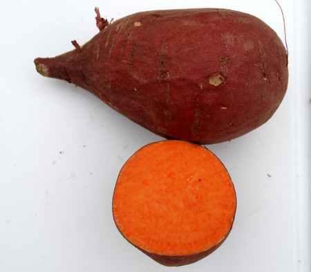 chaat: Carolina Ruby Sweet potato, Red Yam, , Ipomoea batatas, a vine with tuberous roots used as vegetable, skin brown to reddish, flesh orange yellow, sweet, eaten baked as chaat Stock Photo