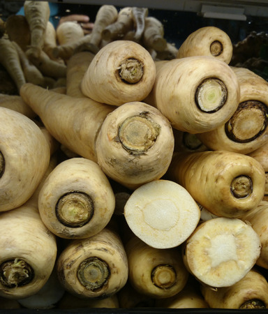 tuberous: Parsnip, Pastinaca sativa, root vegetable with long tuberous roots with cream colored skin and creamish flesh becoming sweeter in flavor, eaten raw or cooked.