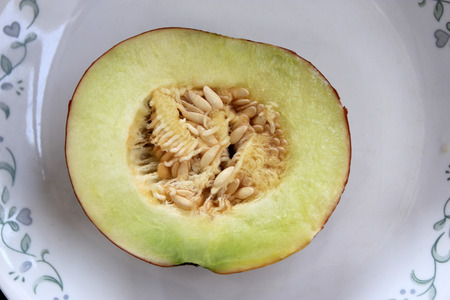 var: Cucumis melo var cantalupensis, Hogen, cantaloupe with yellow, orange to finally brown skin with broad green stripes The flesh is light greenish-white, sweet and juicy Used as table fruit