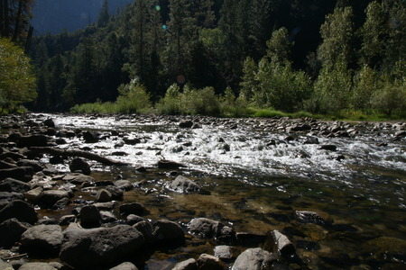 producing: Mountain stream, Yosemite National Park, Sierra Nevada, California , in ravines between mountain slopes, stones and boulders in bed producing white snowy effect