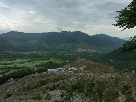 tunnel view: View of Kashmir valley from Titanic point on Kashmir side of Jawahar tunnel, with forested slopes and rice fields in the valley. Stock Photo