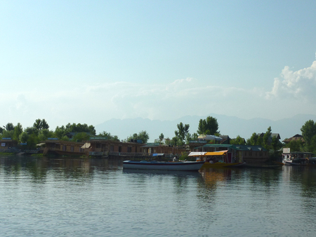 lodging: Dal Lake, Srinagar, Kashmir, with House boats for boarding and lodging, floating gardens for vegetable growing and shikaras carrying visitors Editorial