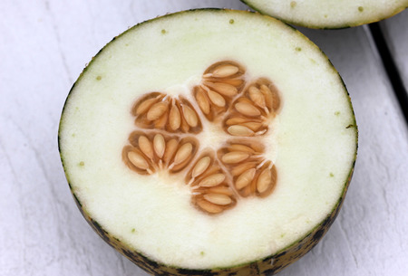 golden section: Dosakaya fruit section, Cucumis melo subs. agrestis var conomon, resembling golden cucumber but with green patches turning darker on ripening, flesh white, used in sambar and pachadi preparations