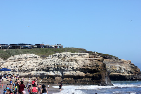 frequented: Rock formations along Natural Bridges Beach California, forming natural bridges, frequented by sea gulls, great enjoyment for tourists  Keywords:along beach bridges califo Editorial