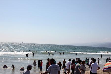 monica: Santa Monica Beach, San Diego California, USA, tourists enjoying the sunbath, shore tides and parasailing