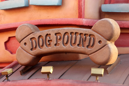 seemingly: Dog Pound, Disneyland, Anaheim California, USA, twisting seemingly strong rods is a childs play