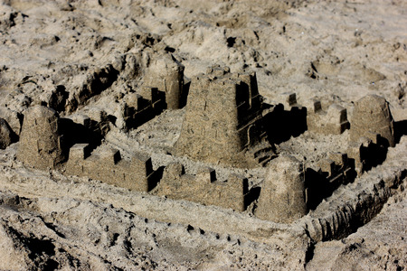 beautifully: Sand castle on Natural Bridges Beach, beautifully crafted by children playing around on the beach Stock Photo