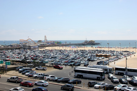 seekers: Parking Lot, Santa Monica Beach and Pacific Park, California, USA, big attraction for beach lovers and amusement seekers