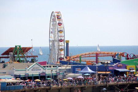 seekers: Giant Wheel, Santa Monica Beach Pacific Park, California, USA, and a portion of Roller Coaster, big attraction for amusement seekers