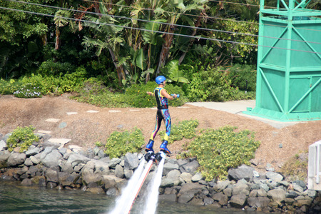 propel: Flyboarding at Cirque De La Mer Show, SeaWorld, San Diego, California, USA, HydroJet propulsions taking artist several feet high with turns, flips, and dives midair, Skyboarding