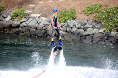 cirque: Flyboarding at Cirque De La Mer Show, SeaWorld, San Diego, California, USA, HydroJet propulsions taking artist several feet high with turns, flips, and dives midair, Skyboarding