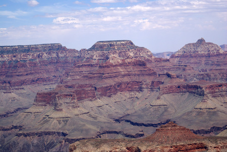 periods: Grand Canyon, Arizona, United States, uplifted mountain formation, steep sided carved by Colarado river over millions of years, rock strata formed during different periods