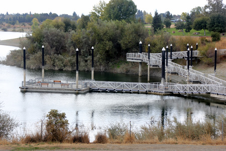 recreational area: Recreational area of Quarry Lake, Fremont, California with steps leading to dock, facilities for swimming, fishing and boating, with several birds around.