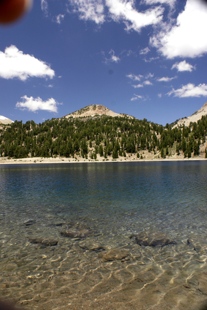 Lake Helen in July, Lassen Volcanic National Park, California, glacial lake located below Lassen Peak ay Altitude of 2500 m in Shasta Cascade Region, remaining covered with snow most of the year. Stock Photo