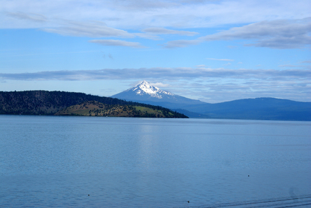 Upper Klamath Lake, shallow freshwater lake east of Cascade Range in south-central Oregon, USA , rich in fish, blue green algae, snow covered peak of Mt. McLoughlin in background.