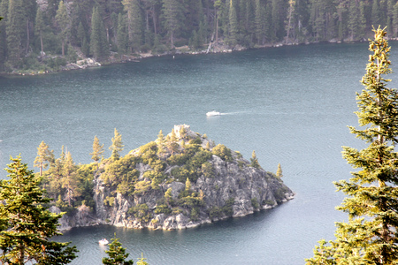 Fannette Island in the middle of Emerald Bay on California side of Lake Tahoe on west shore, USA, granite rock with few conifers and remains of Tea House on top. Stock Photo