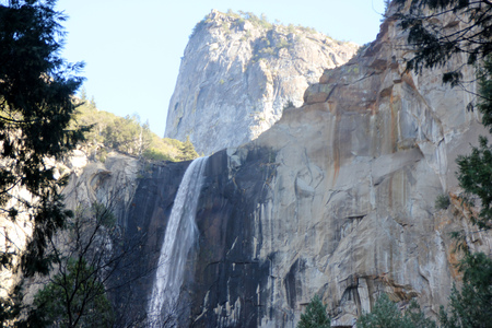 Bridalveil Fall, Yosemite National Park, California, zoomed in view from Parking Lot with Cathedral Rock above,  189 m high waterfall with light swaying flow on November 23, thickest and thundering in spring