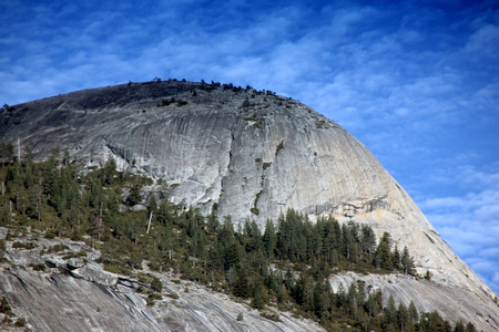 North Dome, Yosemite National Park, California, zoomed in view from Curry Village Half Dome Parking, a granite rock, southernmost summit of Indian Ridge. Stock Photo