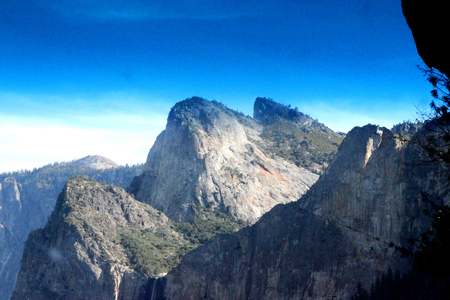 Cathedral Rocks, Yosemite National Park, zoomed in view from Tunnel View, three prominent peaks, Upper and Miidle visible, Lower partially visible, climb a real challenge for hikers.