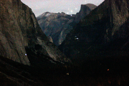 Early night view of peaks from Tunnel view, Yosemite National Park, California, with traffic lights, camping sites and mountaineers climbing on rocks mainly El Capitan on left. 스톡 콘텐츠 - 92465495