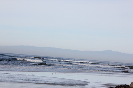 Spanish Bay Beach in Pebble beach area, 17 mile drive, California, USA, sandy beach with rocky banks and beautiful surfing waters with regular enjoyable waves. Stok Fotoğraf