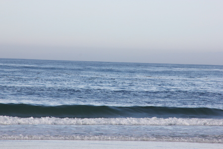Spanish Bay Beach in Pebble beach area, 17 mile drive, California, USA, sandy beach with rocky banks and beautiful surfing waters with regular enjoyable waves. Stock Photo