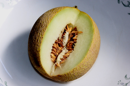 Galia melon, Sarda in India and Persia, Cucumis melo var  reticulatus, a melon up to 1 5 kg in size with light yellow to dark yellow reticulated skin and greenish white flesh, almost green beneath the skin  Flesh is crisp and sweet