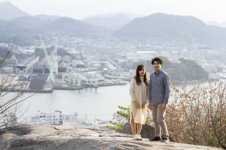 Portrait of young man and woman with Onomichi Channel