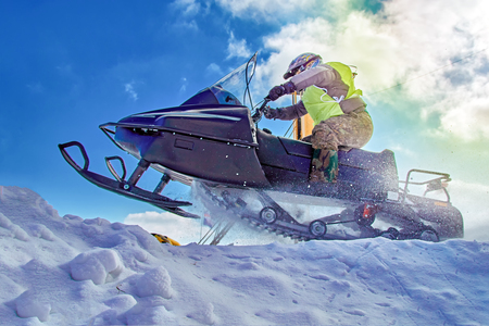 Extreme sport for lifestyle design. Winter extreme sport Snowmobile racing. Sport winter background for any purposes. 스톡 콘텐츠