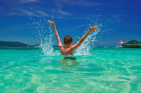 Child splashing in sea