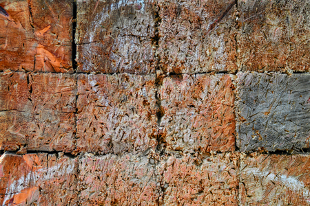 Wood texture of the target with white silhouette of the man. Target for throwing with traces, scratches, holes. Old surface for wallpaper design. Banco de Imagens