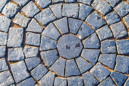 Paving. Square cobblestone circular pattern. Pavement in Vintage Design Flooring Square Pattern Texture Background 스톡 콘텐츠
