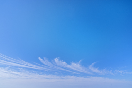 Light white cirrus clouds in the blue sky on a summer day. Good weather 版權商用圖片