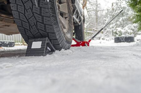 Rubber Wheel Chock, anti-rollback stop under the wheel of the car on the snow. Wheel Chocks anti-skid Vehicle Wheel.
