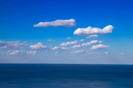 Beautiful natural sea landscape in sunny day. Beauty world, blue sky with white clouds. Deep blue backdrop, background wallpaper.