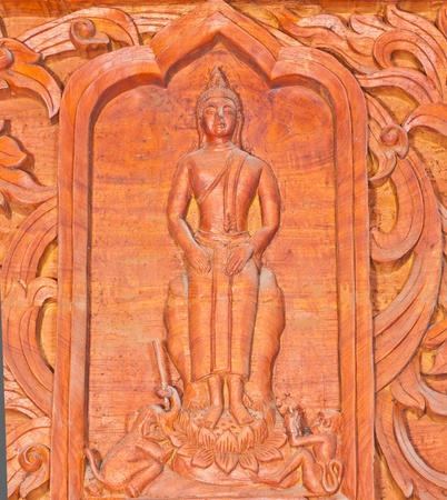 Old wooden carving in Thai style photo