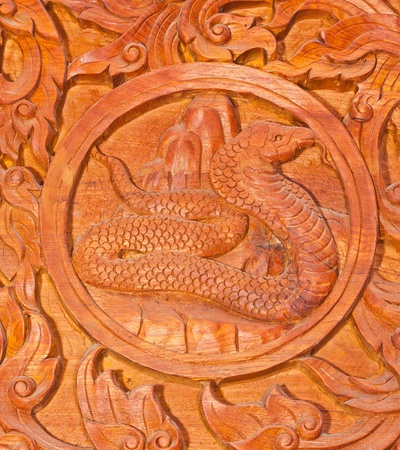 Traditional Thai style wood carving as rat one of 12 Zodiac,Generality in Thailand, any kind of art decorated in Buddhist church etc. created with money donated by people, no restrict in copy or use