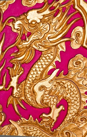 Golden dragon on the red wall of Chinese temple  photo