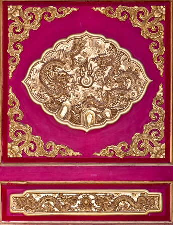 Golden dragon on the red wall of Chinese temple  Stock Photo