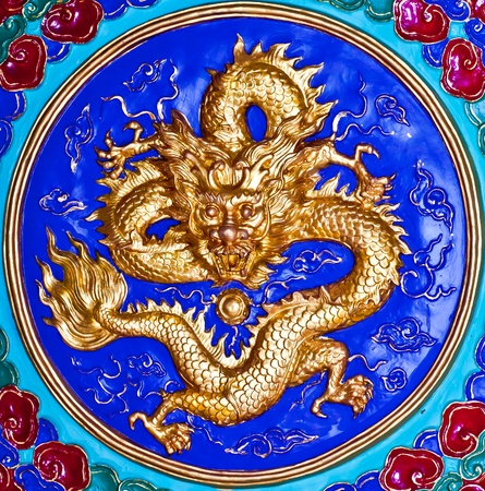 Golden Dragon, Colorful chinese dragon at the wall of temple, Thailand  photo