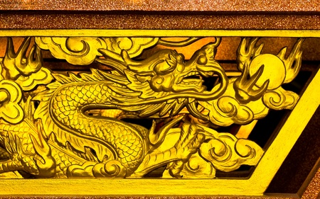 Golden Dragon carved on wood Stock Photo - 13421295