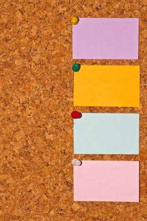 papers on cork board Stock Photo - 13650696