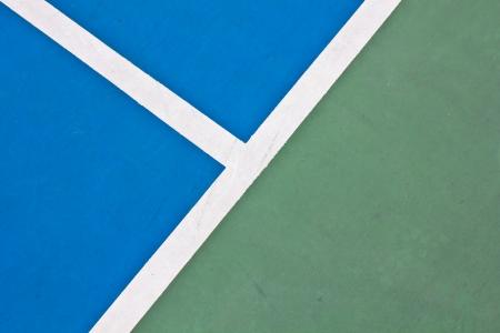 racket stadium: Tennis court white intersecting lines