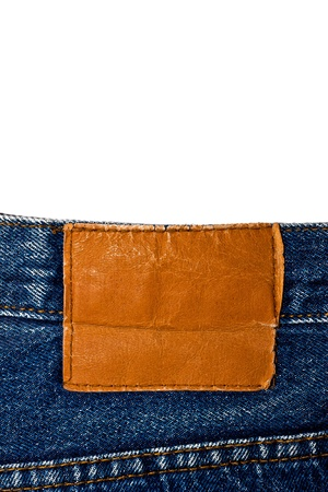 Blank  leather  jeans label sewed on a blue jeans isolated on white  photo