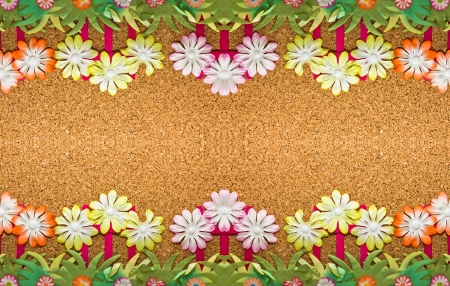 Paper flowers on a cork board Stock Photo - 15076139