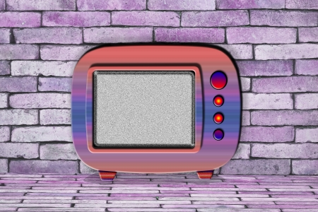 television set in front of brick wall Stock Photo