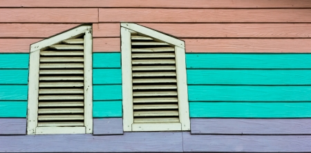 Windows and a colorful wood background Stock Photo - 17997420