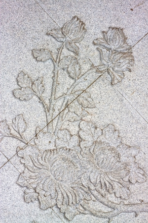 Flower carved on stone wall  photo