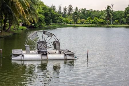 aerator: Chaipattana Low Speed Surface Aerator is Water mill to make the good environment Stock Photo